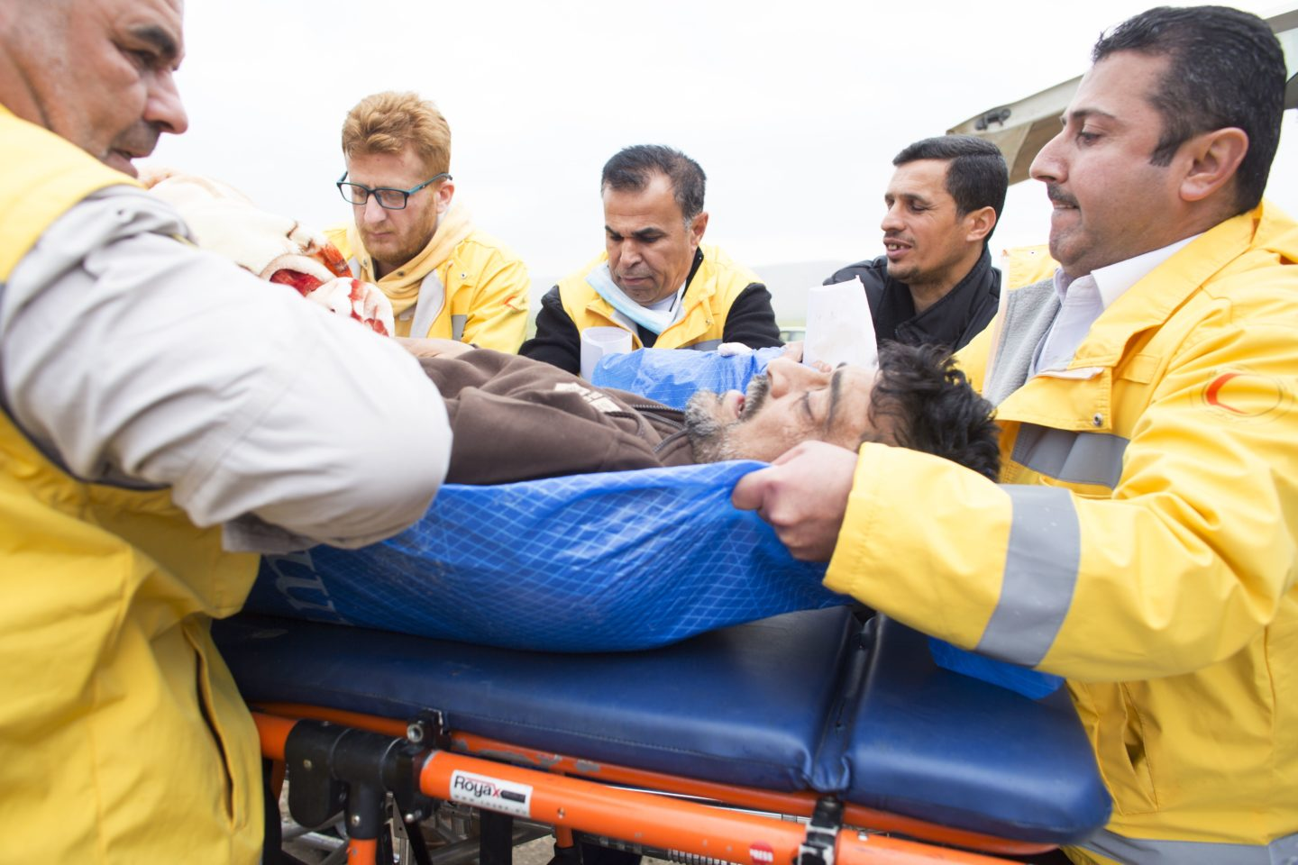 Injured man from Mosul being put into ambulance