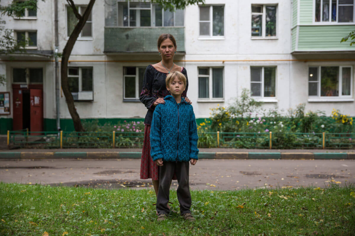 Yulia Fedosova and her son Maxim outside their family home, which is scheduled for demolition.